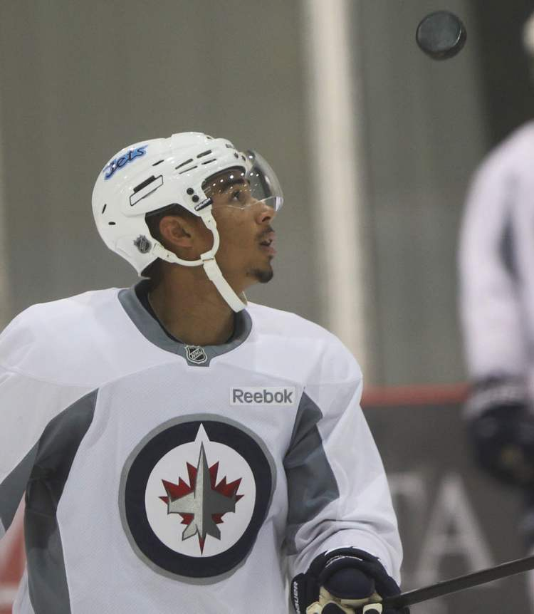 Evander Kane does some fancy stick work with the puck.