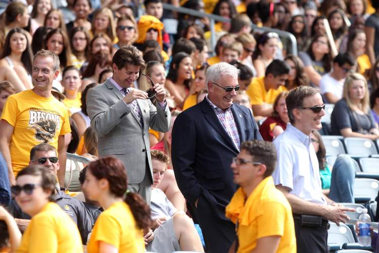 University of Manitoba pep rally at Investors Group Field Tuesday afternoon - President Dr. David T. Barnard walks through crowd of students to greet them (JOE BRYKSA / WINNIPEG FREE PRESS)