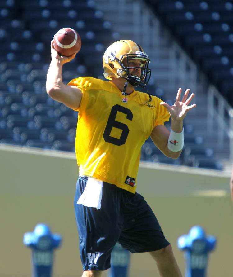Newly signed QB Levi Brown looks to throw the ball at practice.