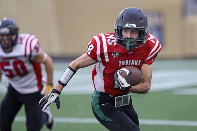 Vincent Massey Trojans quarterback Sam Blakely runs with the ball. (JOE BRYKSA / WINNIPEG FREE PRESS)