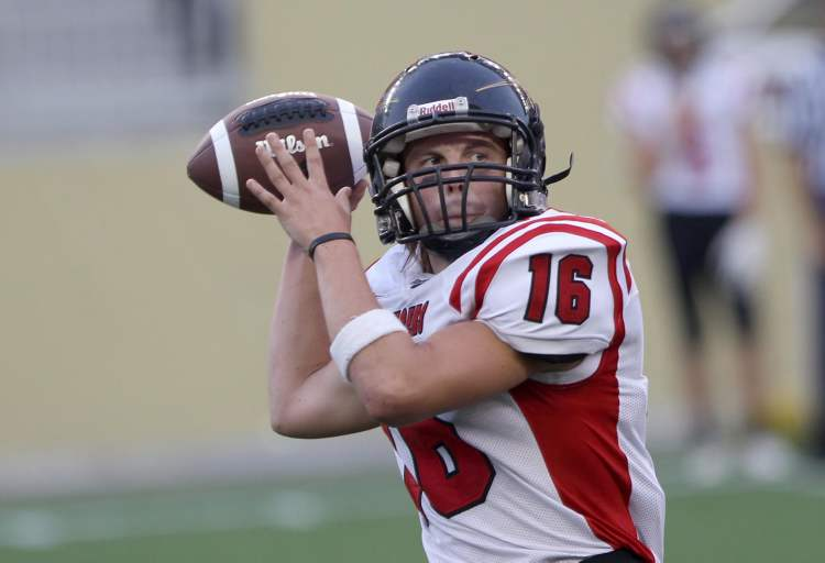 Dakota Lancers quarterback Ben Christensen keeps looks down-field to throw the ball. (JOE BRYKSA / WINNIPEG FREE PRESS)