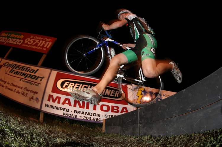 A cyclocross racer participates in Darkcross, an annual race at the Red River Coop Speedway, Saturday, September 7, 2013. (TREVOR HAGAN/WINNIPEG FREE PRESS)
