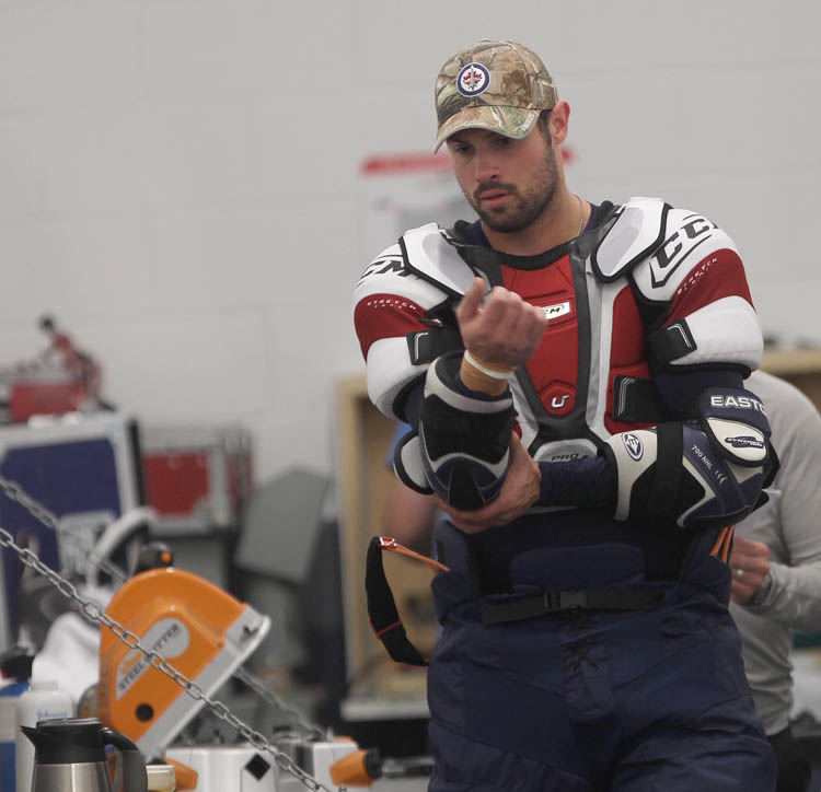Zach Bogosian sheds his gear after Tuesday's skate. (Joe Bryksa / Winnipeg Free Press)