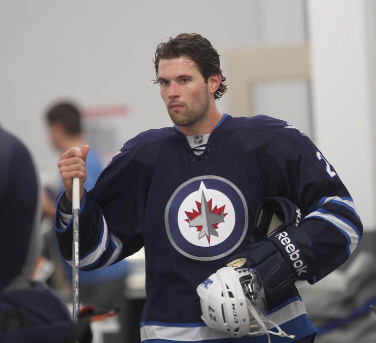 Forward Eric Tangradi leaves practice. (Joe Bryksa / Winnipeg Free Press)
