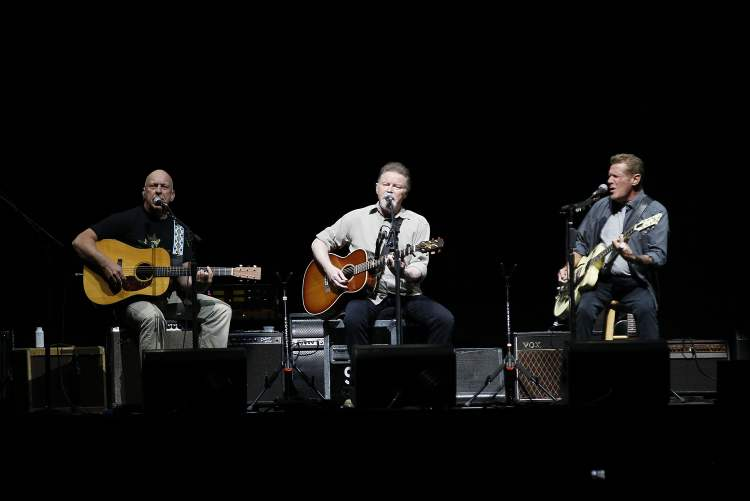 Bernie Leadon (left), Don Henley (centre) and Glenn Frey play an acoustic number.