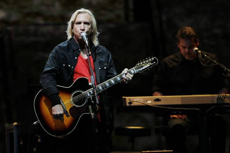 Joe Walsh plays a 12-string acoustic guitar while singing. (John Woods / Winnipeg Free Press)