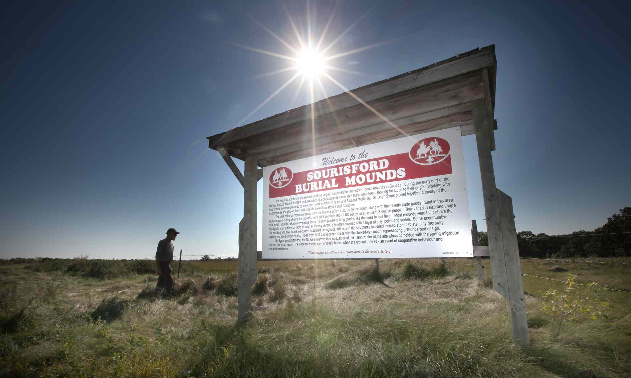 This contentious sign outside Linear Mounds may be removed. Dakota object to the label 'Burial Mounds.'