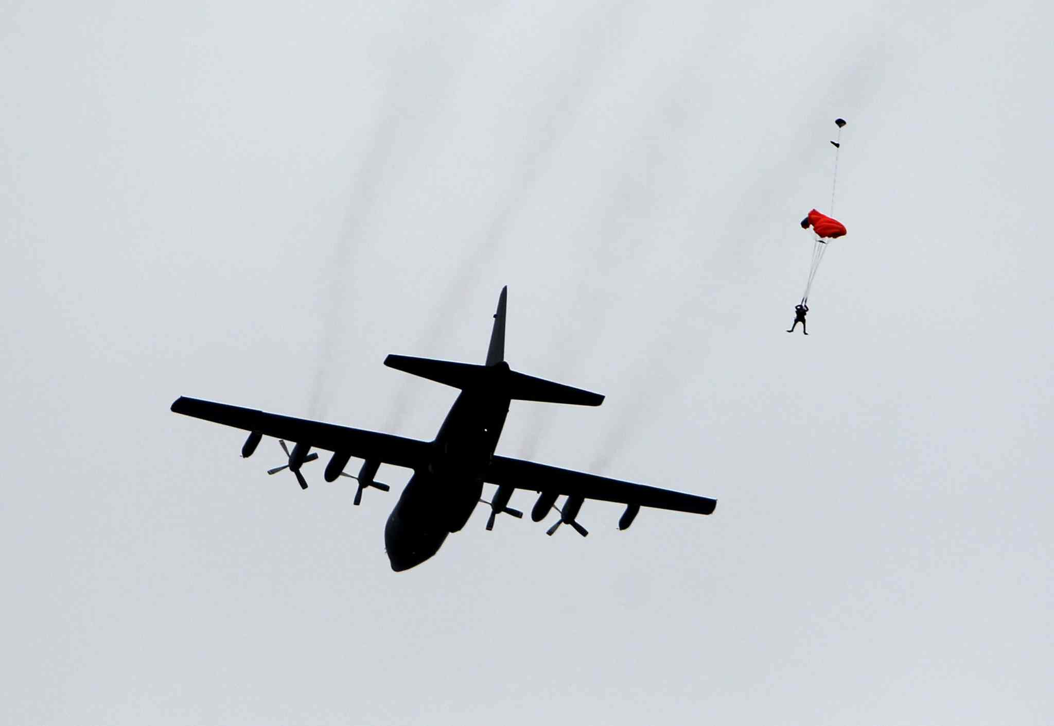 A SAR tech parachutes from a Canadian Forces Hercules aircraft over Lake Winnipeg.