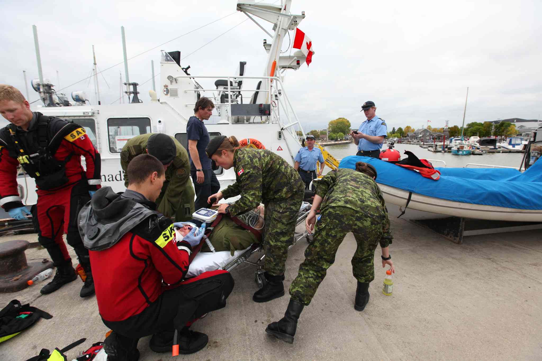 As part of an exercise, SAREX Marine Rescue Search and Rescue responders had to parachute from a Hercules airplane into Lake Winnipeg near a stranded boat and climb aboard their vessel to accomplish their mission.
