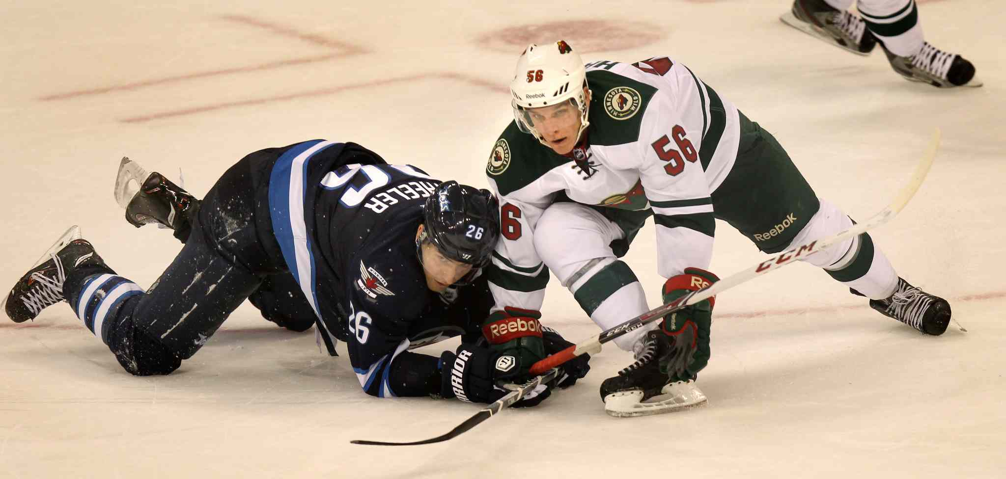Blake Wheeler is taken out by Erik Haula in the third period.