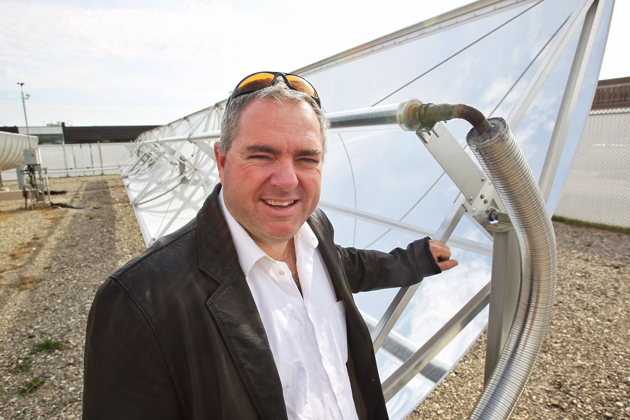Eric Bibeau,industrial research chair at the University of Manitoba, at the Solar Trough test site at Red River College.