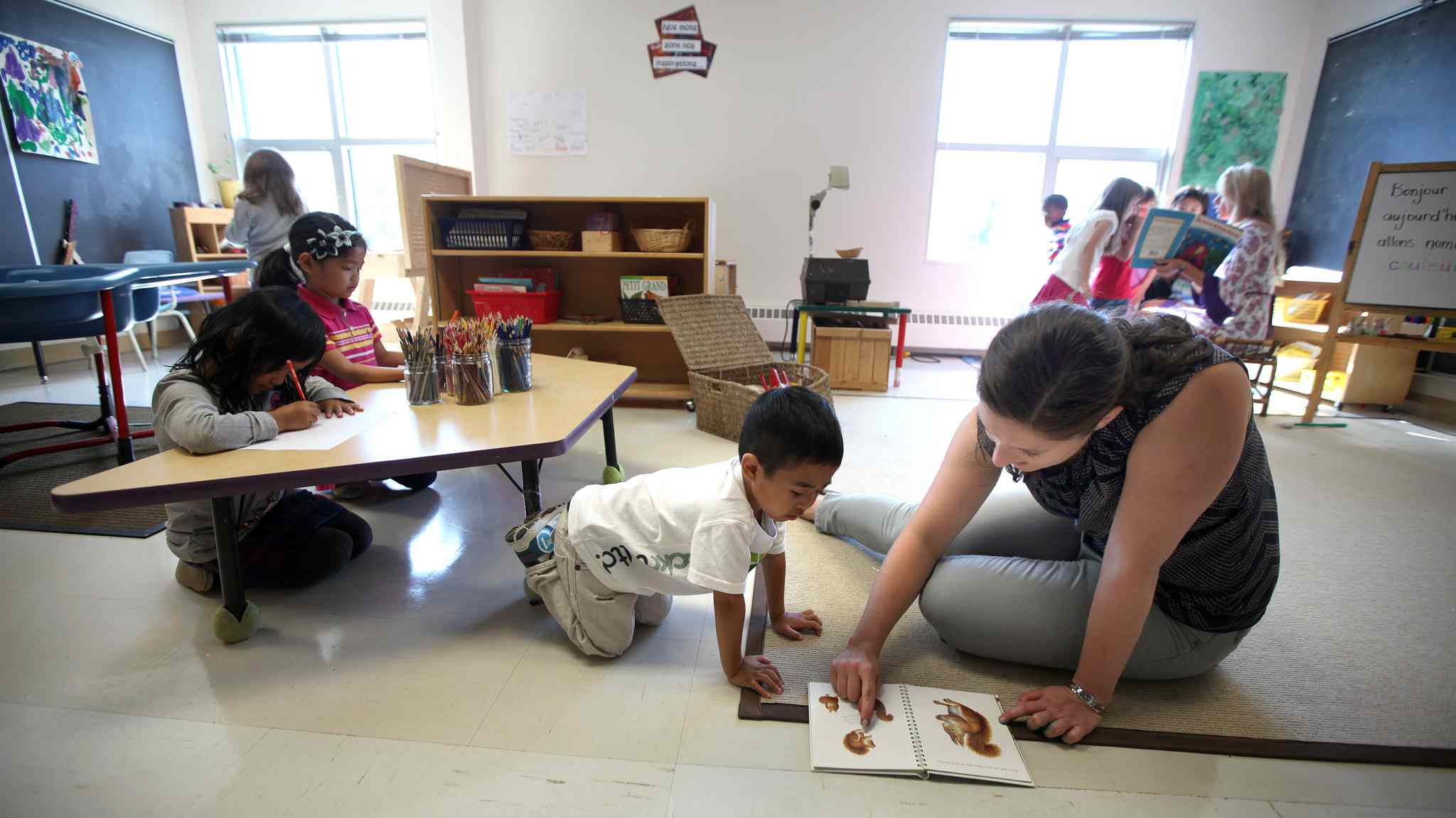 Kindergarten teacher Arielle Gaudet works with her class at Edward Finney School in the Maples.