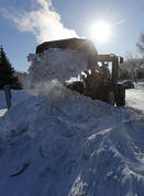 Remember last winter? Winnipeg City snow ploughing operations to clear and scrape hard packed streets on Jan. 2 2014
