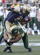 Winnipeg Blue Bombers' Chad Simpson (5) fumbles the ball after getting sandwiched by Edmonton Eskimos' JC Sherritt (47) and Edmonton Eskimos' T.J. Hill (12 Thursday at Canad Inns Stadium.