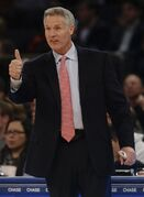 Philadelphia 76ers' head coach Brett Brown gestures to a player during the first half of an NBA basketball game against the New York Knicks, Saturday, Nov. 22, 2014, in New York. (AP Photo/Frank Franklin II)