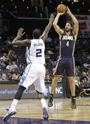 Indiana Pacers' Luis Scola (4) shoots over Charlotte Hornets' Marvin Williams (2) during the first half of a preseason NBA basketball game in Charlotte, N.C., Thursday, Oct. 23, 2014. (AP Photo/Chuck Burton)