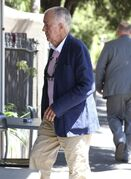 John O'Brien, one of the first hostages to escape a deadly siege last month, enters a cafe after attending a hearing at the New South Wales state Coroner's Court in Sydney, Thursday, Jan. 29, 2015. The coroner's inquest - a court-like proceeding convened after unusual deaths in Australia - is aimed at determining how hostages and the gunman died, and whether the tragedy could have been prevented. (AP Photo/Rick Rycroft)