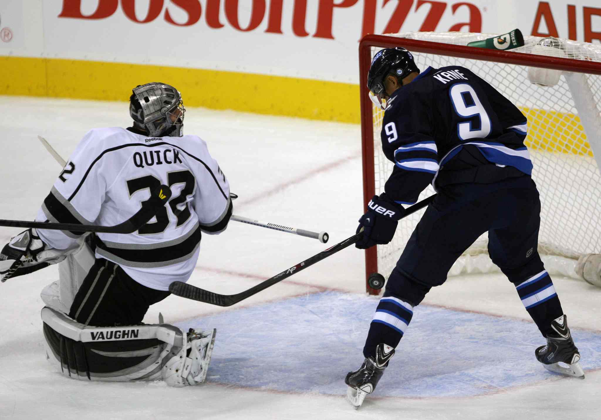 Winnipeg Jets Evander Kane swipes at a loose puck behing Kings goaltender Jonathan Quick during the first period.