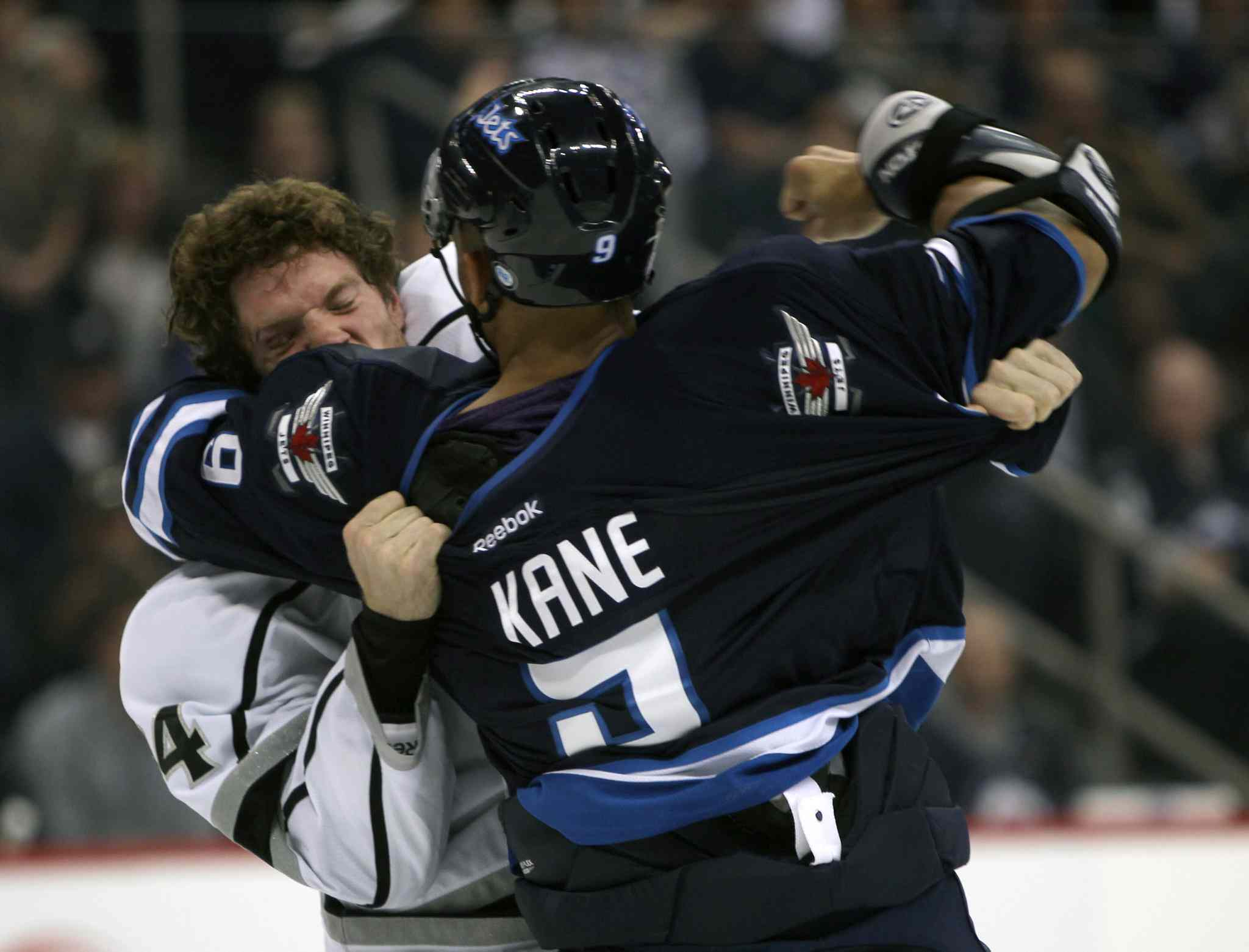 Winnipeg Jets Evander Kane fights with Colin Fraser during the second period.