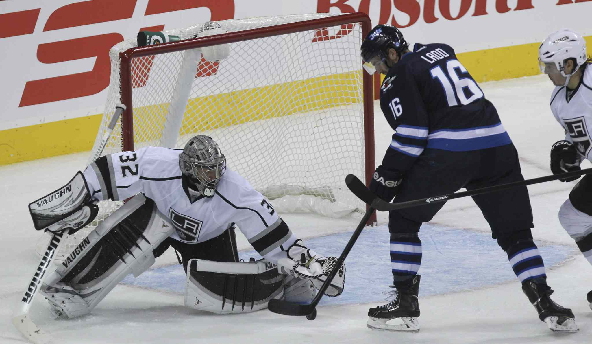 Winnipeg Jets' Andrew Ladd (16) tries to stuff the puck past Los Angeles Kings' goaltender Jonathan Quick (32) in the second period.