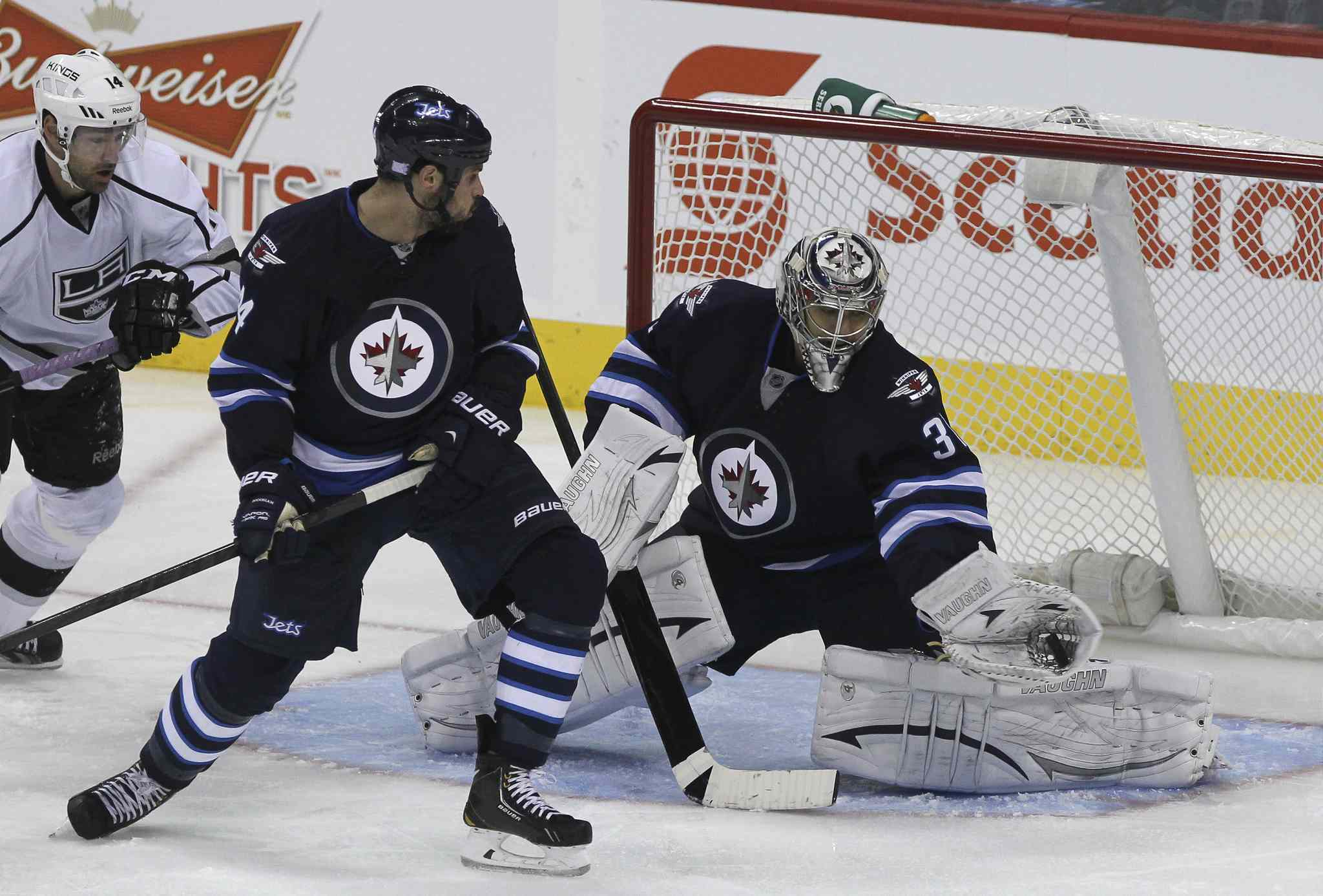 Winnipeg Jets' goaltender Ondrej Pavelec (31) makes a glove save in the third period.