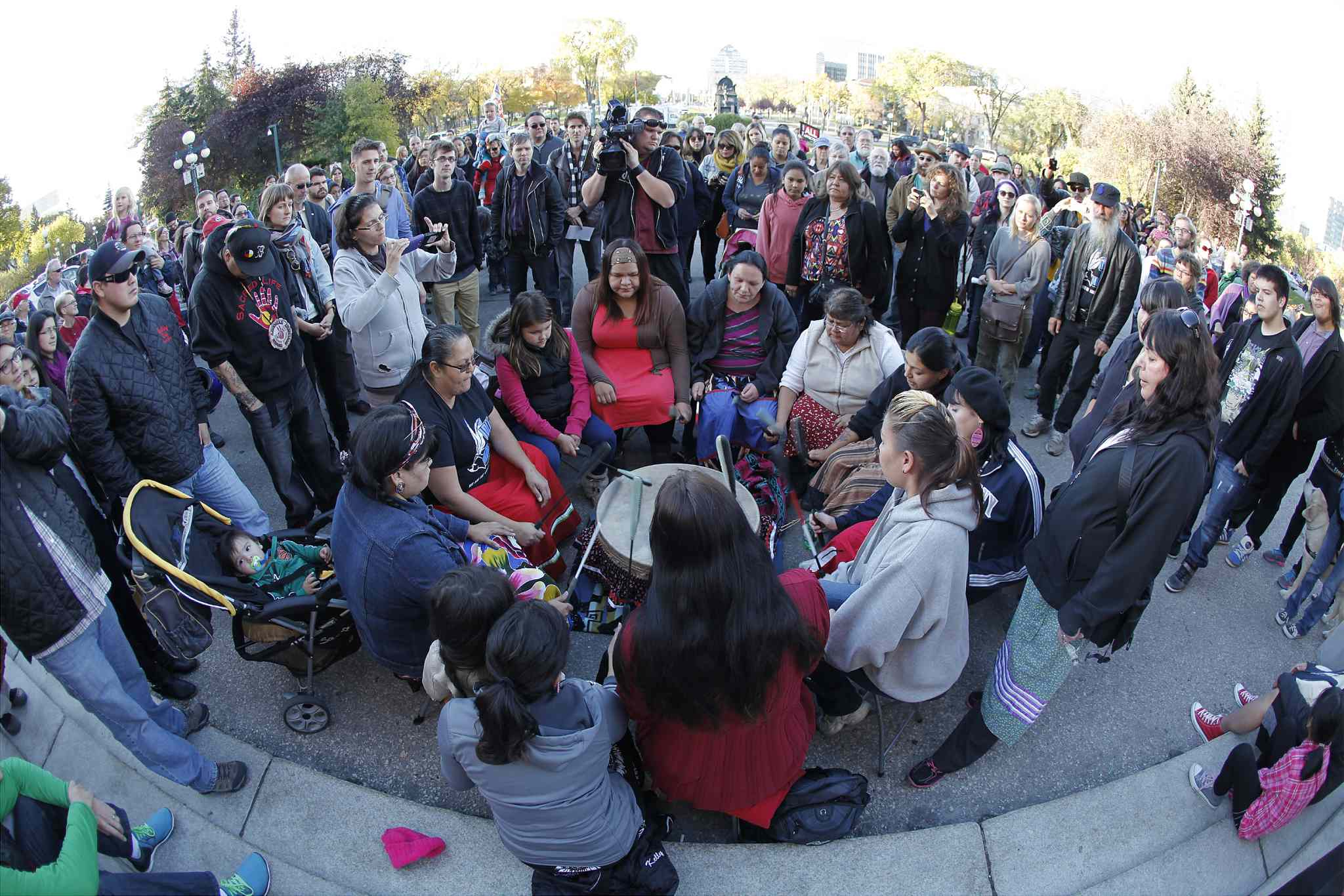 Idle No More supporters gather at the Manitoba legislature in Winnipeg as part of a global day of action Monday.
