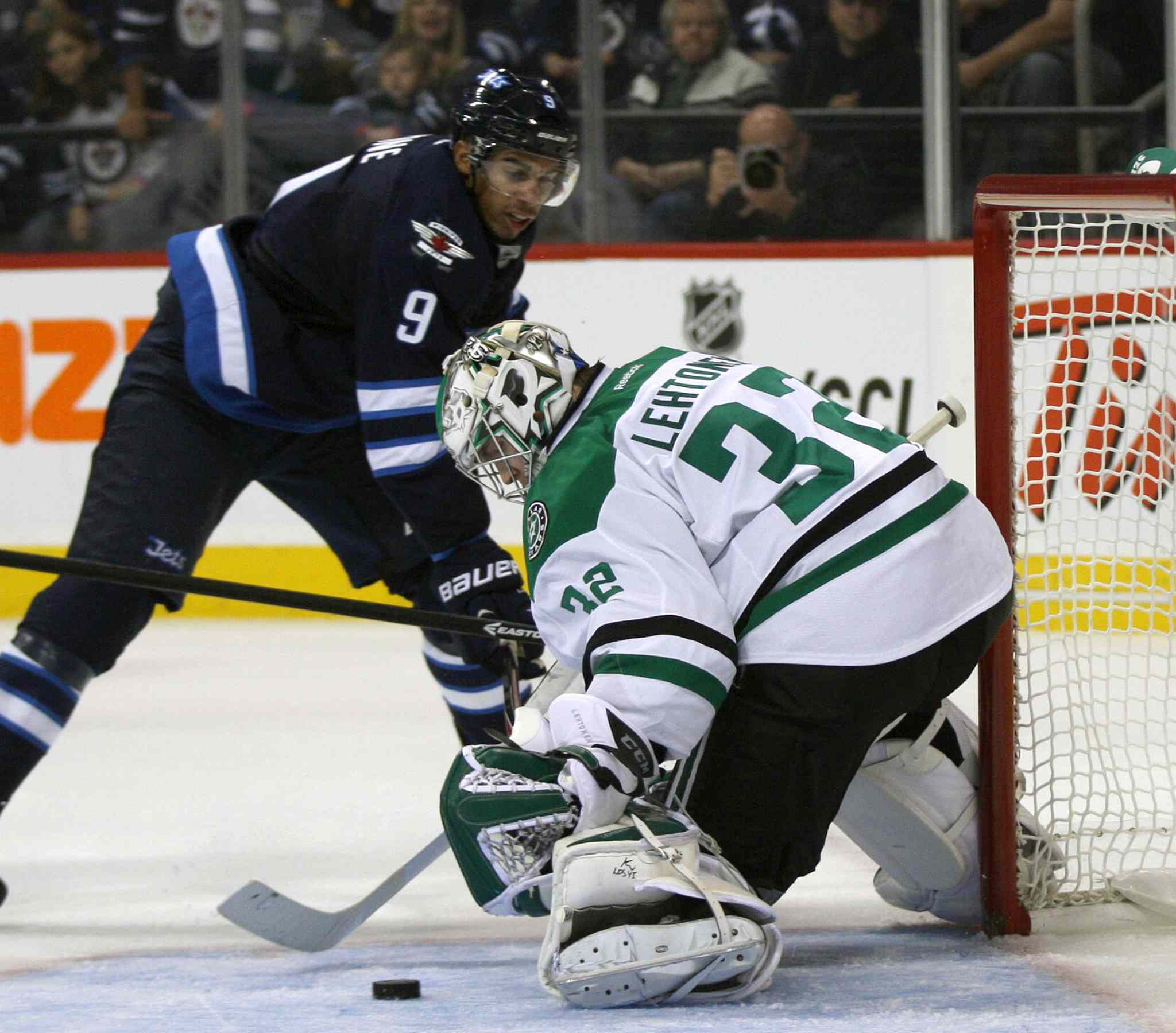 Evander Kane gets a shot on Dallas Stars goaltender Kari Lehtonen during the second period.