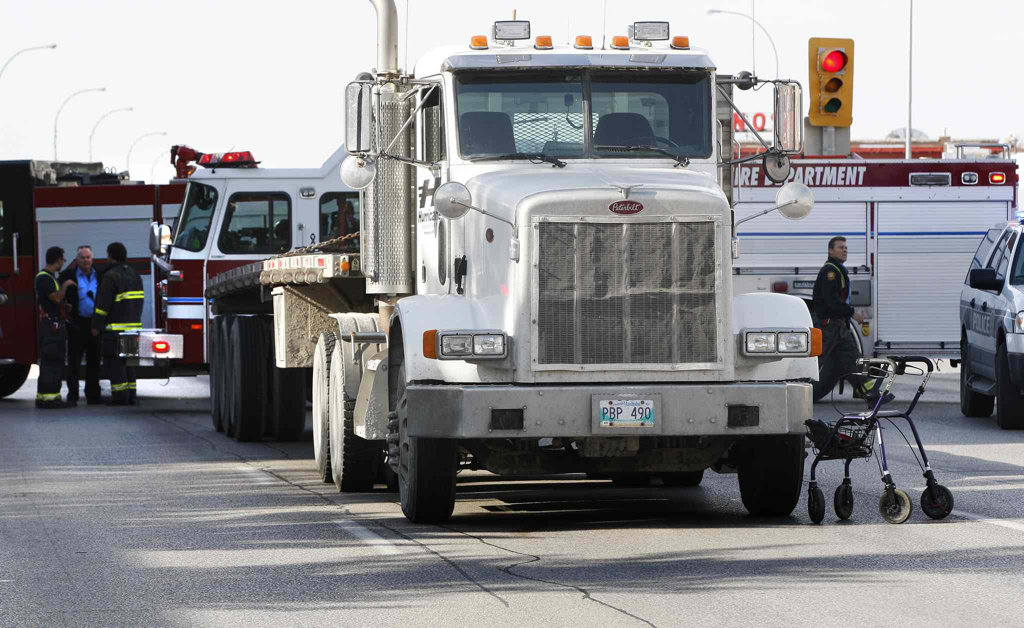 An elderly man was struck by a semi while crossing the eastbound lane of Portage Avenue at Berry Street. The eastbound lane is completely closed  and the westbound lane is slow going through the area.