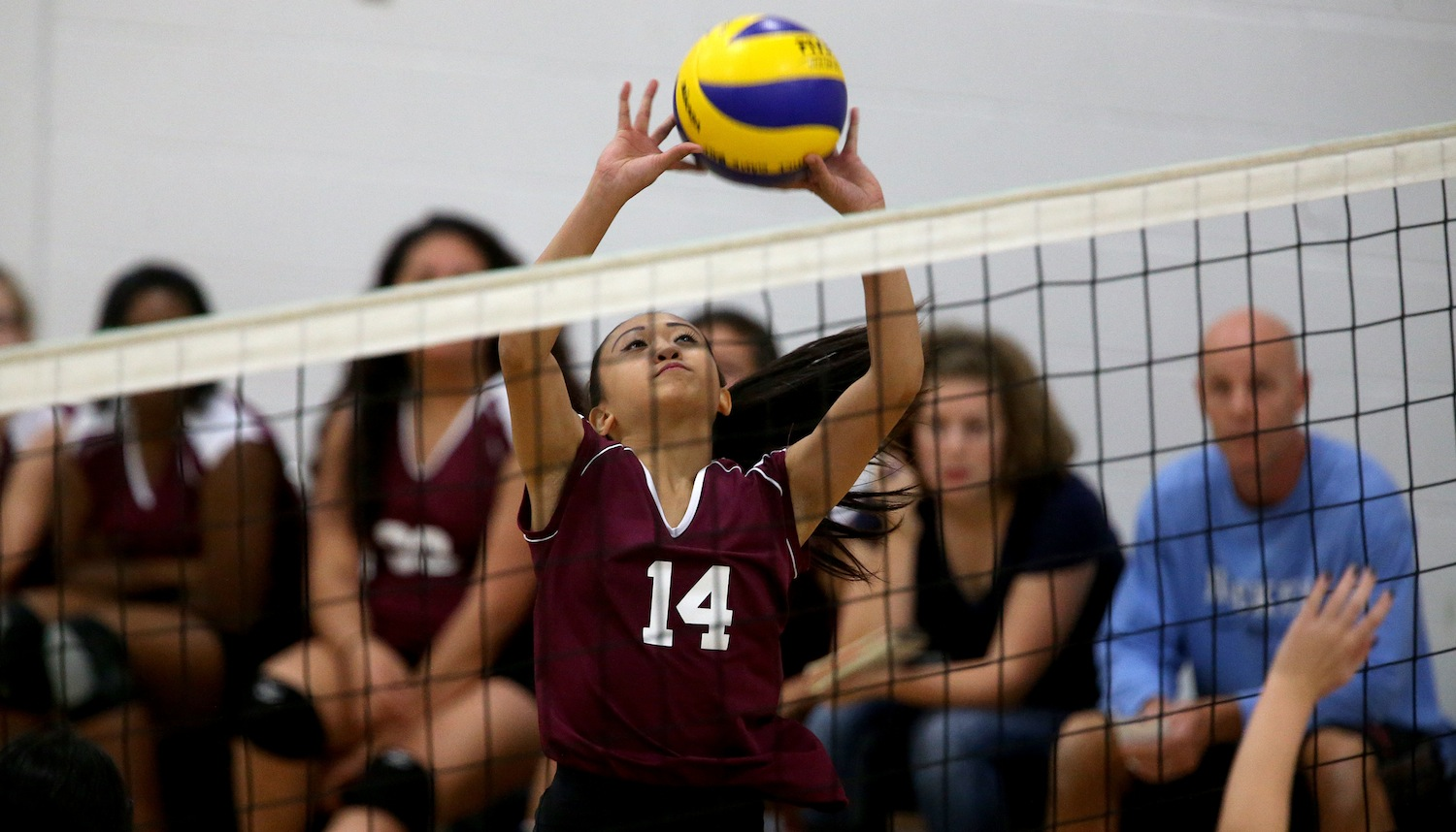 Charisse Ahmad sets the ball for the DMCI Maroons.