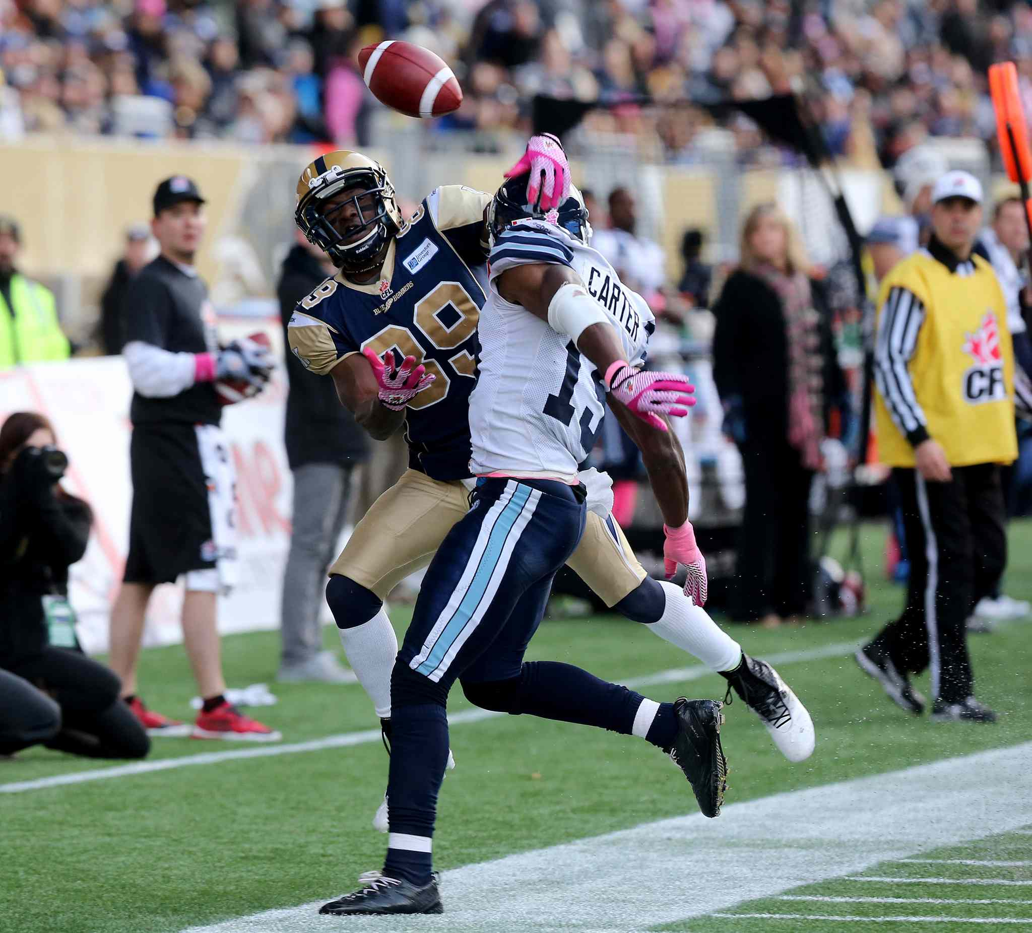 Winnipeg Blue Bombers' Clarence Denmark (89) tries unsuccessfully to bring in a pass as he's forced out of bounds by Toronto Argonauts' Jalil Carter (19) during the second half.