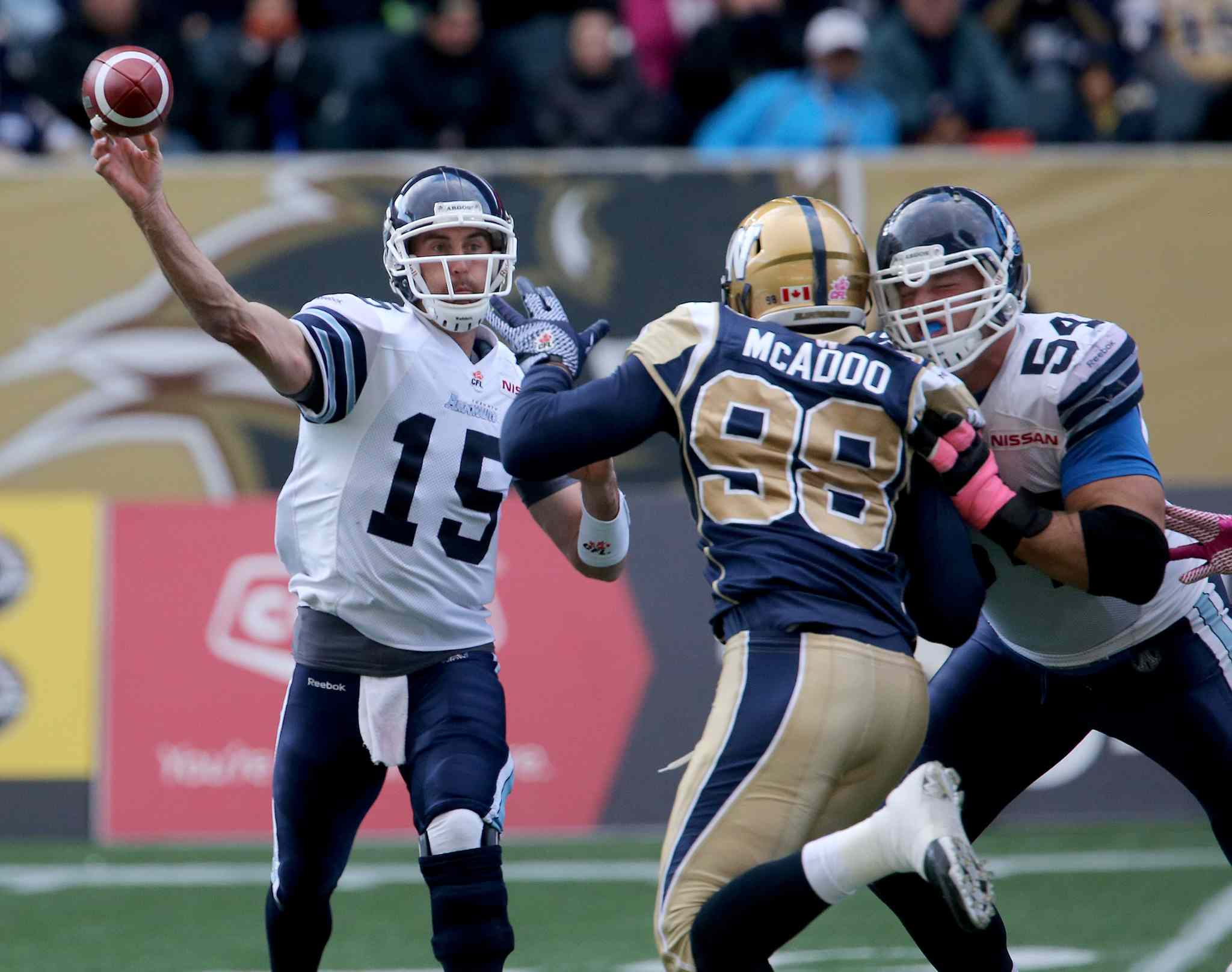 Toronto Argonauts' quarterback Ricky Ray (15) passes a ball that would be knocked down by Winnipeg Blue Bombers' Michael McAdoo (98) during the second half.