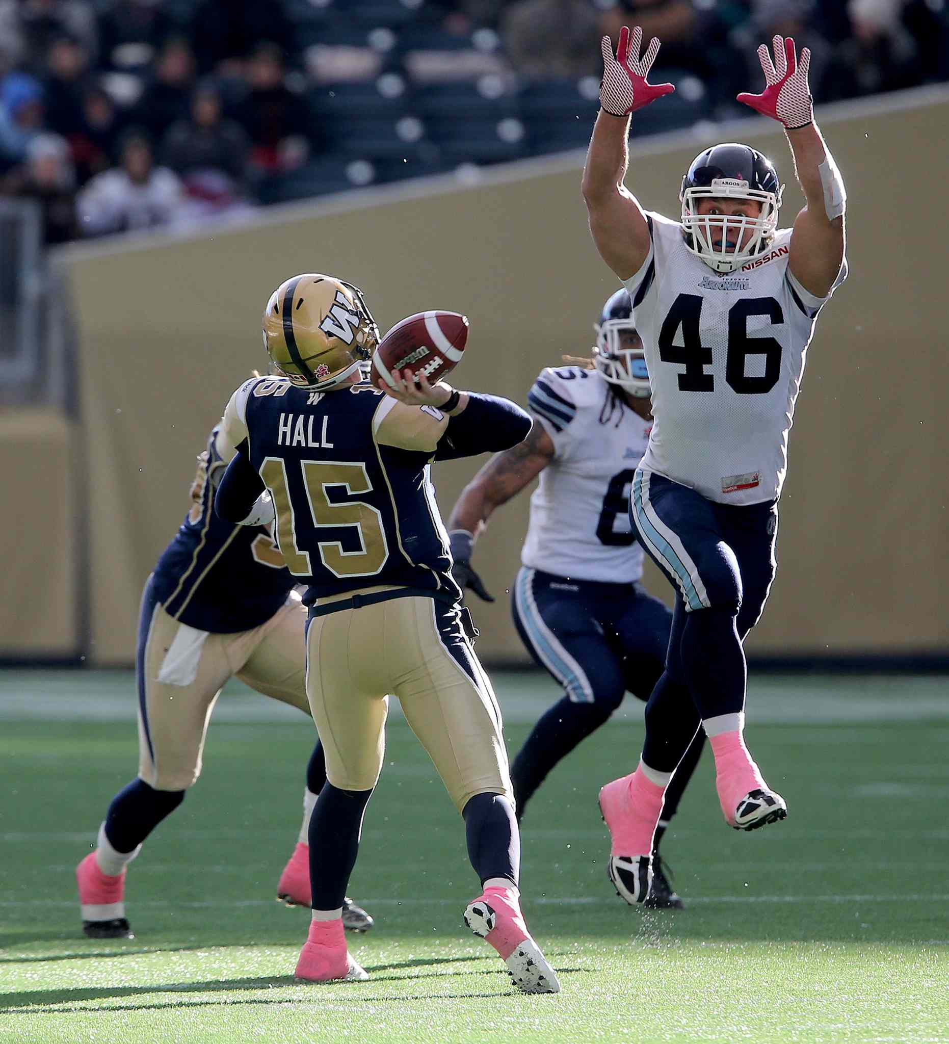 Winnipeg Blue Bombers' quarterback Max Hall (15) manages to throw a long pass over Toronto Argonauts' Jason Pottinger (46) during the second half.