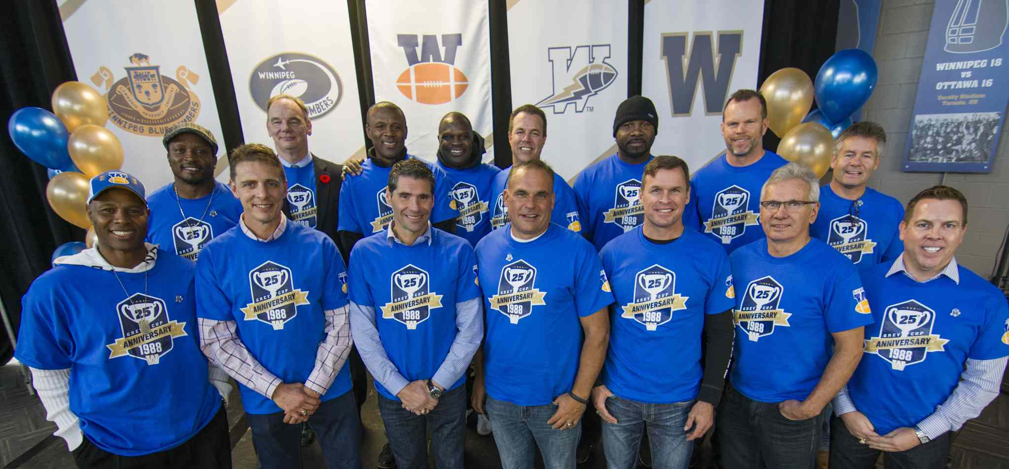 Members of the 1988 Grey Cup champion Winnipeg Blue Bombers pose for a photo at the Pinnacle Club at Investors Group Field Friday afternoon.