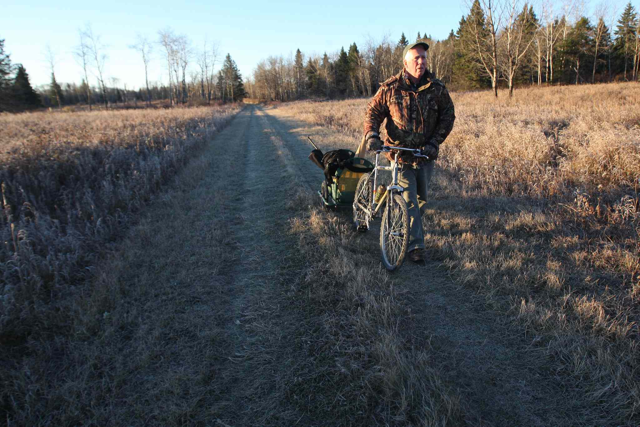 Dr. Vince Crichton- Certified Wildlife Biologist  uses his mountain bike to look for moose in Riding Mountain National Park.   (JOE BRYKSA / WINNIPEG FREE PRESS)