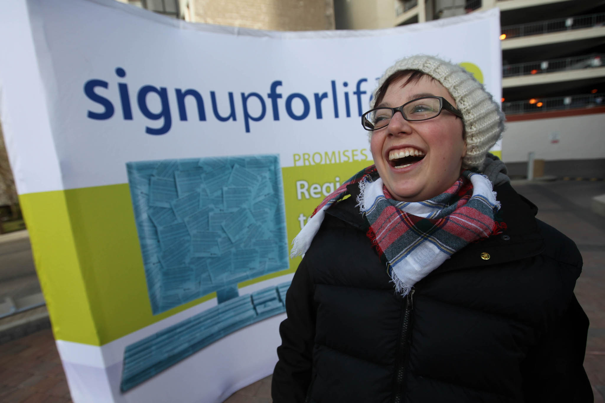 Lung-transplant recipient Hélène Campbell laughs while working out at Portage and Main during the Give2Live Coffee Break Boot Camp workout session Thursday.