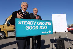 Greg Selinger (left) and Steve Ashton announce a major upgrade to Highway 75