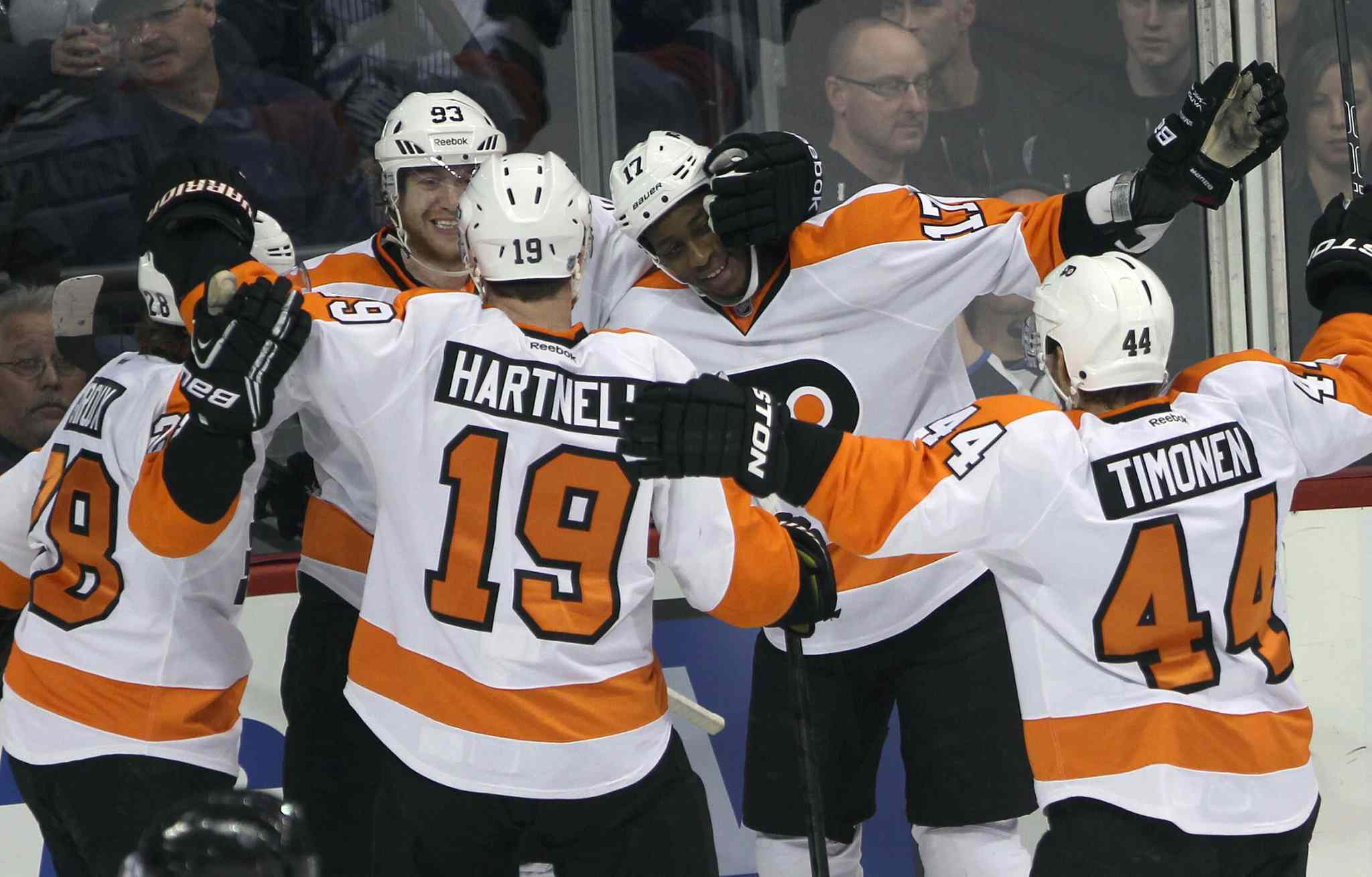 Philadelphia Flyers Wayne Simmonds (top right) is congratulated by teammates on his first-period goal.
