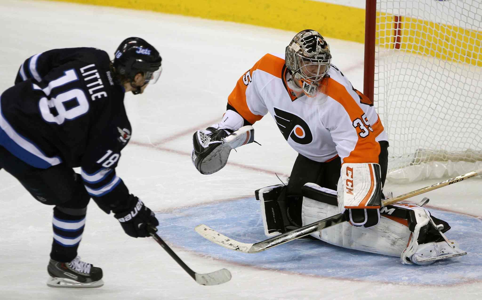 Winnipeg Jets forward Bryan Little scores the game-winner on Philadelphia Flyers goalie Steve Mason in a shootout Friday night.