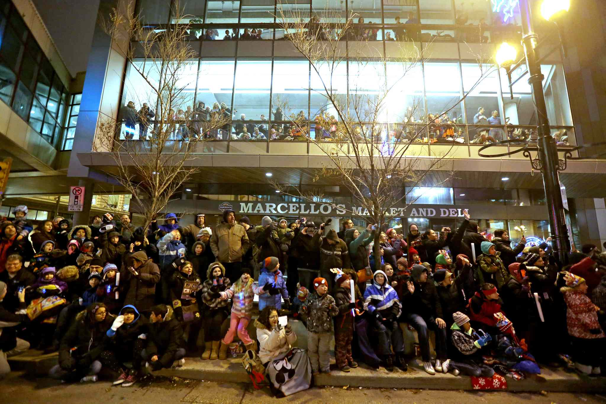 Large crowds gathered in front of the Manitoba Hydro building.