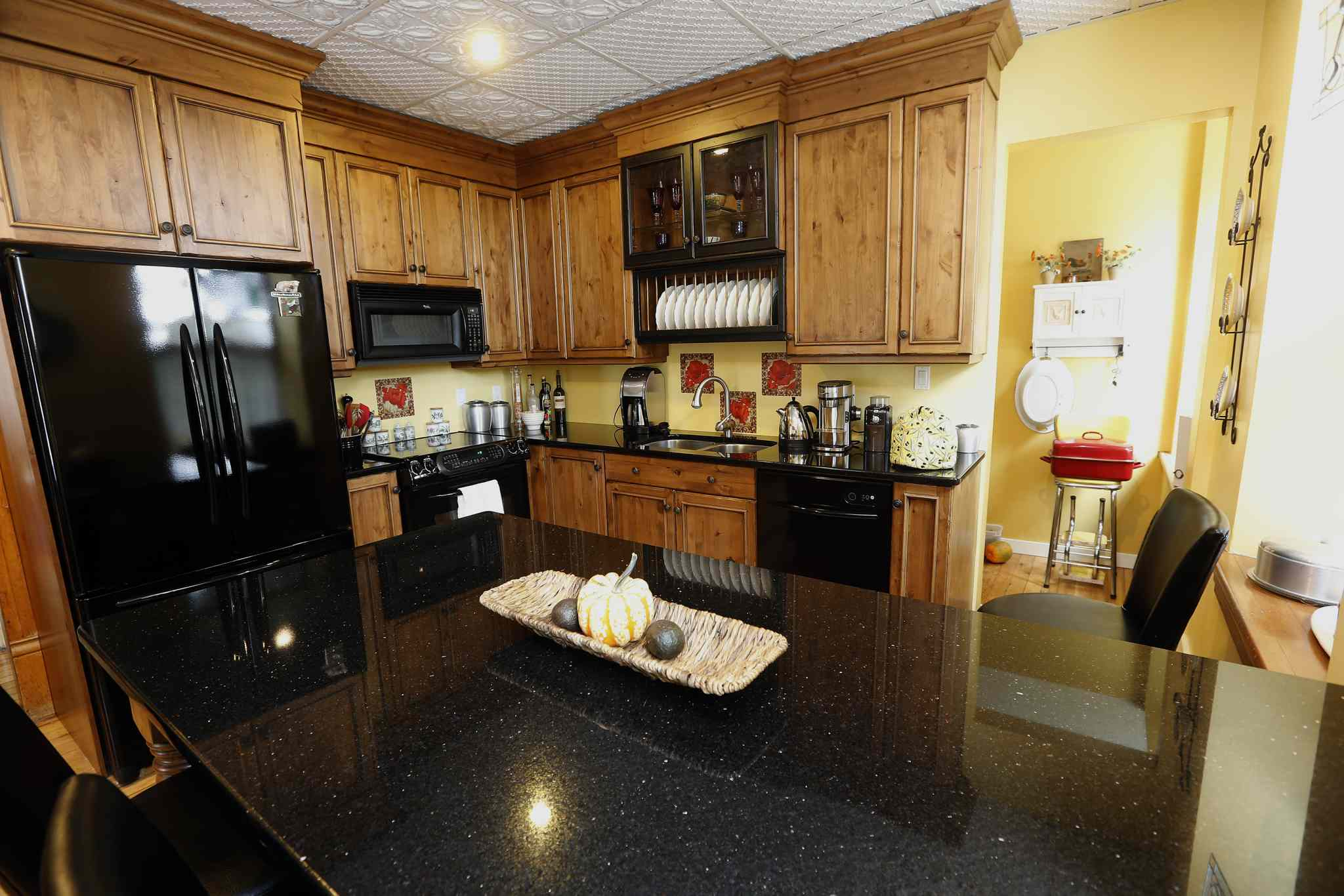 The house's kitchen is quite modern, and features granite counter tops.
