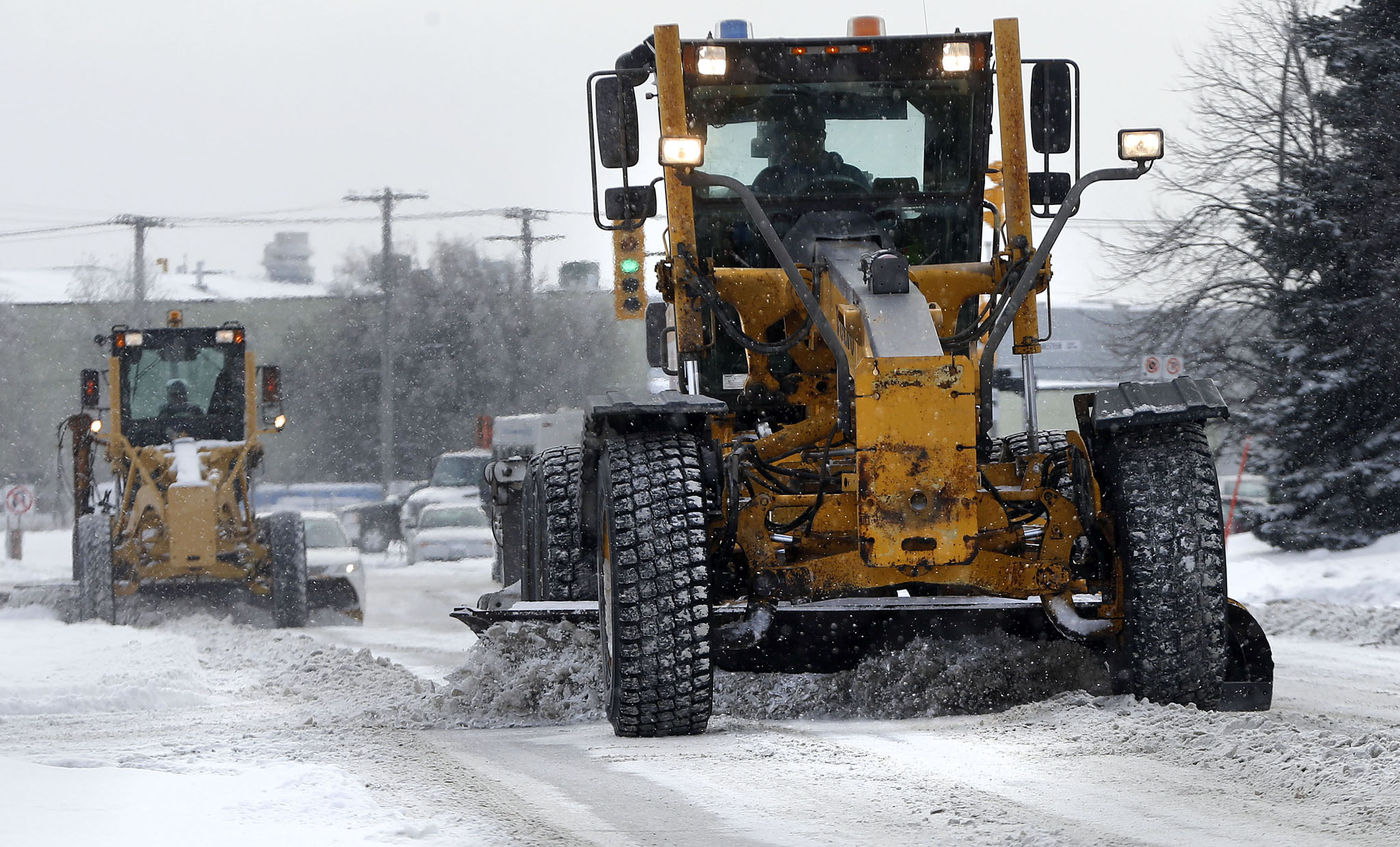 Snow plows will scrape Winnipeg streets New Year's Day.
