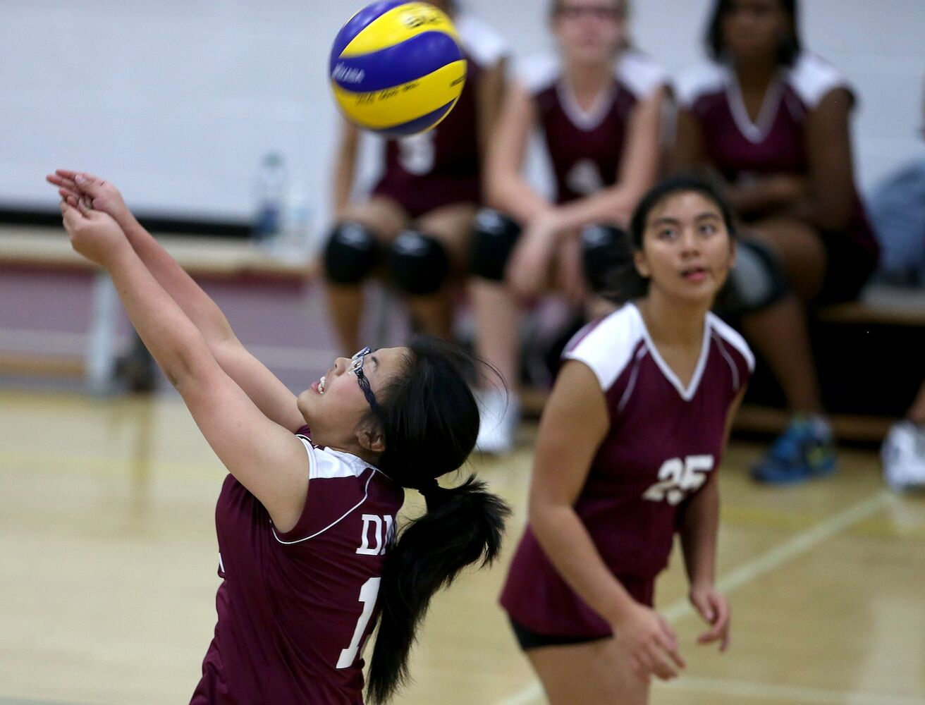 DMCI Maroons' Jayvee Altasin (right) watches as teammate Jacquelynn Joseph bumps the ball. (TREVOR HAGAN / WINNIPEG FREE PRESS)