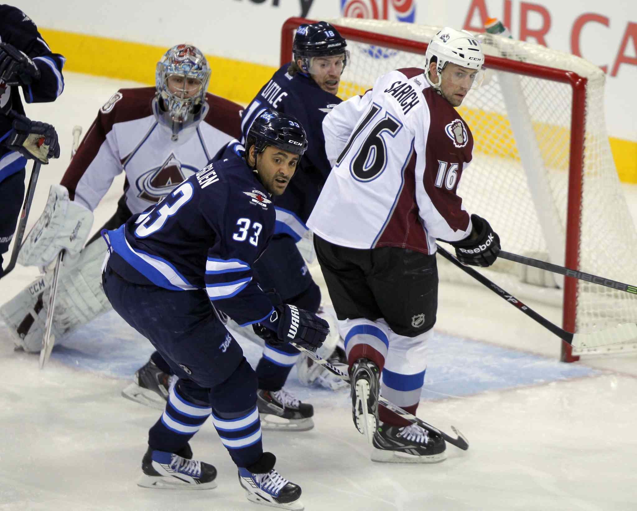 From left: Semyon Varlamov, Dustin Byfuglien, Bryan Little and Cory Sarich track the puck in the first period.