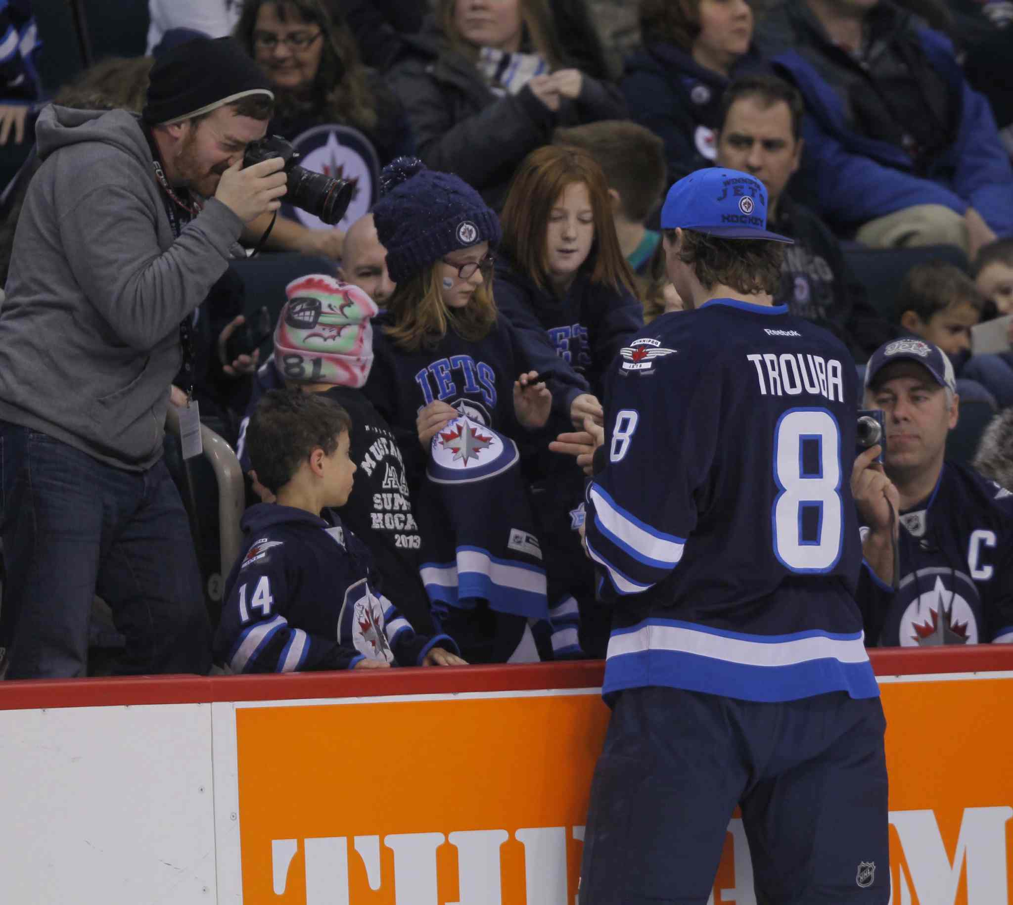 Jacob Trouba signs some autographs.