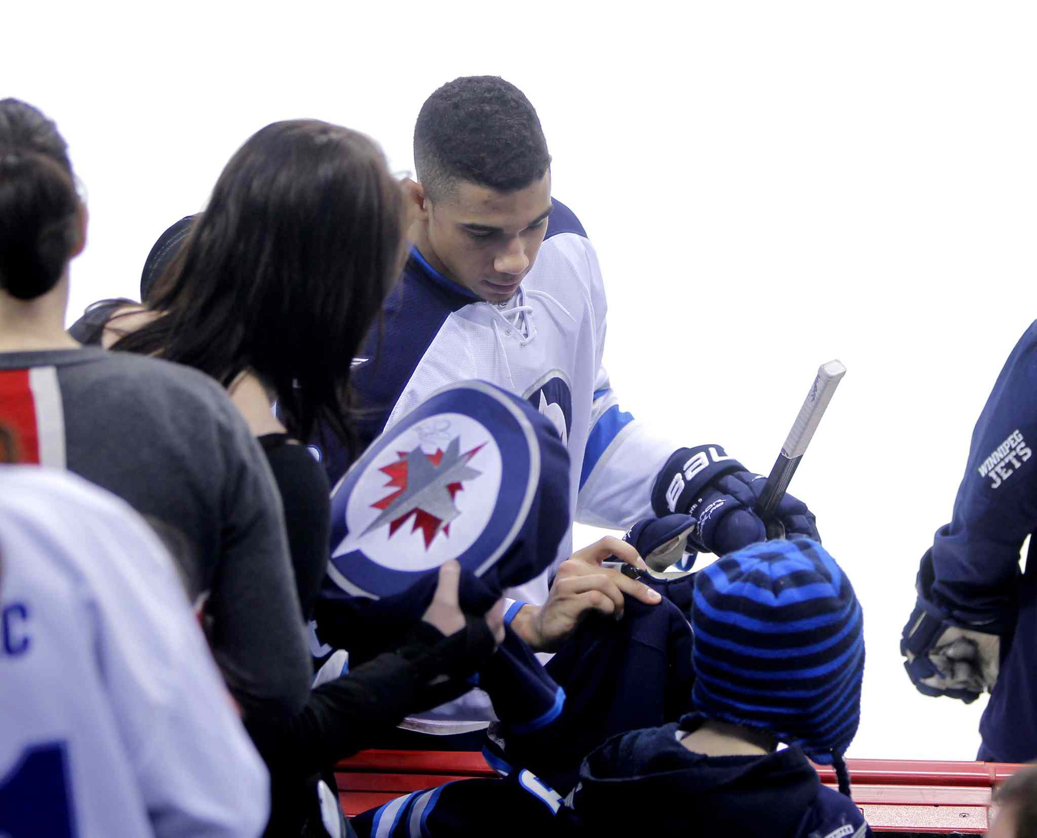 Evander Kane signs some autographs.