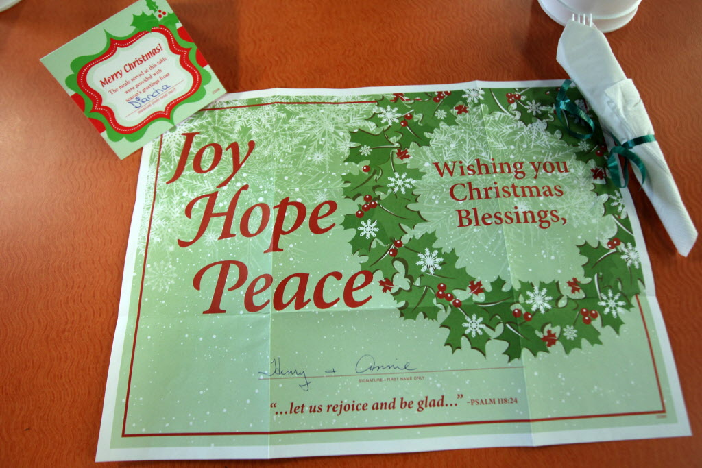 Siloam Mission's Christmas Eve dinner place mats proclaim good wishes for the season. (JOE BRYKSA / WINNIPEG FREE PRESS)