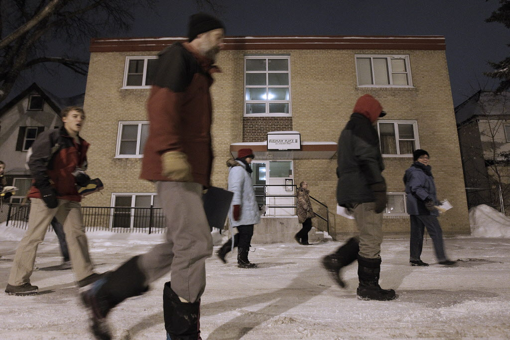 Members of the West Broadway Community Ministry draw attention to the plight of those searching for affordable housing in Winnipeg as they re-enact Joseph and Mary's biblical search for shelter Christmas Eve. (John Woods / Winnipeg Free Press)