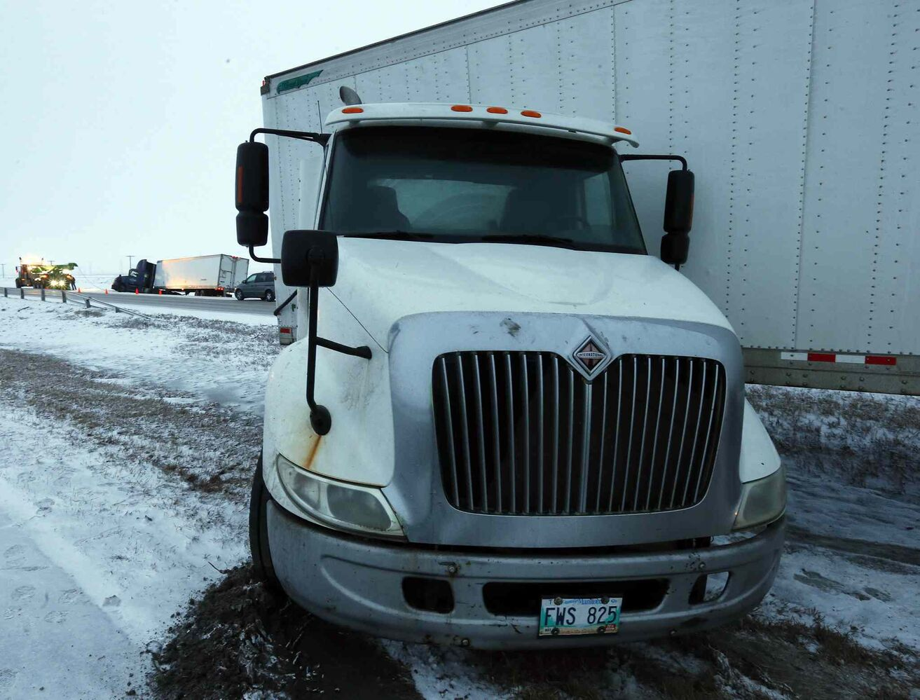 Icy road conditions inside and outside the city led to two semis coming off the road and an SUV rolling over Friday morning/ (KEN GIGLIOTTI / WINNIPEG FREE PRESS)