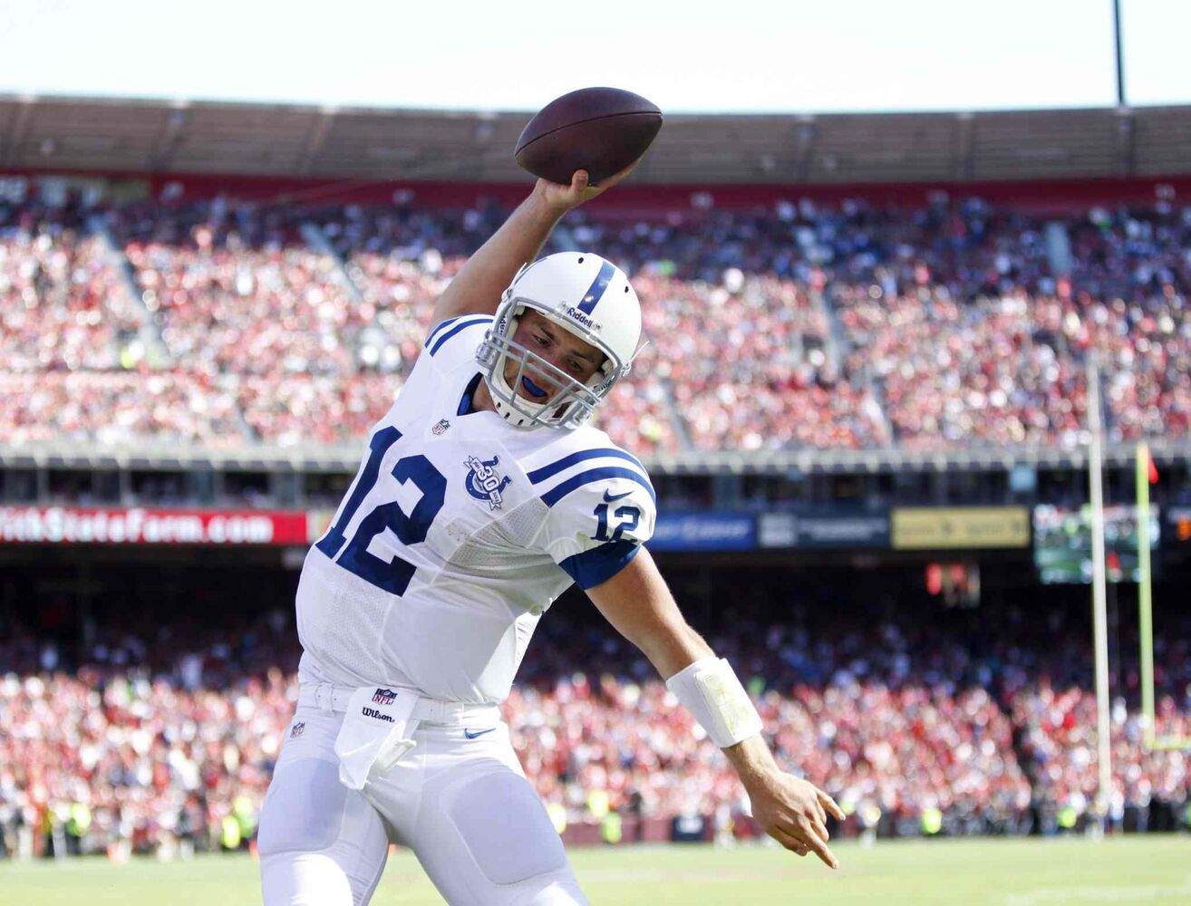 Indianapolis Colts quarterback Andrew Luck celebrates his touchdown in the fourth quarter against the San Francisco 49ers at Candlestick Park in September 2013. (Josie Lepe / Bay Area News Group / MCT files)