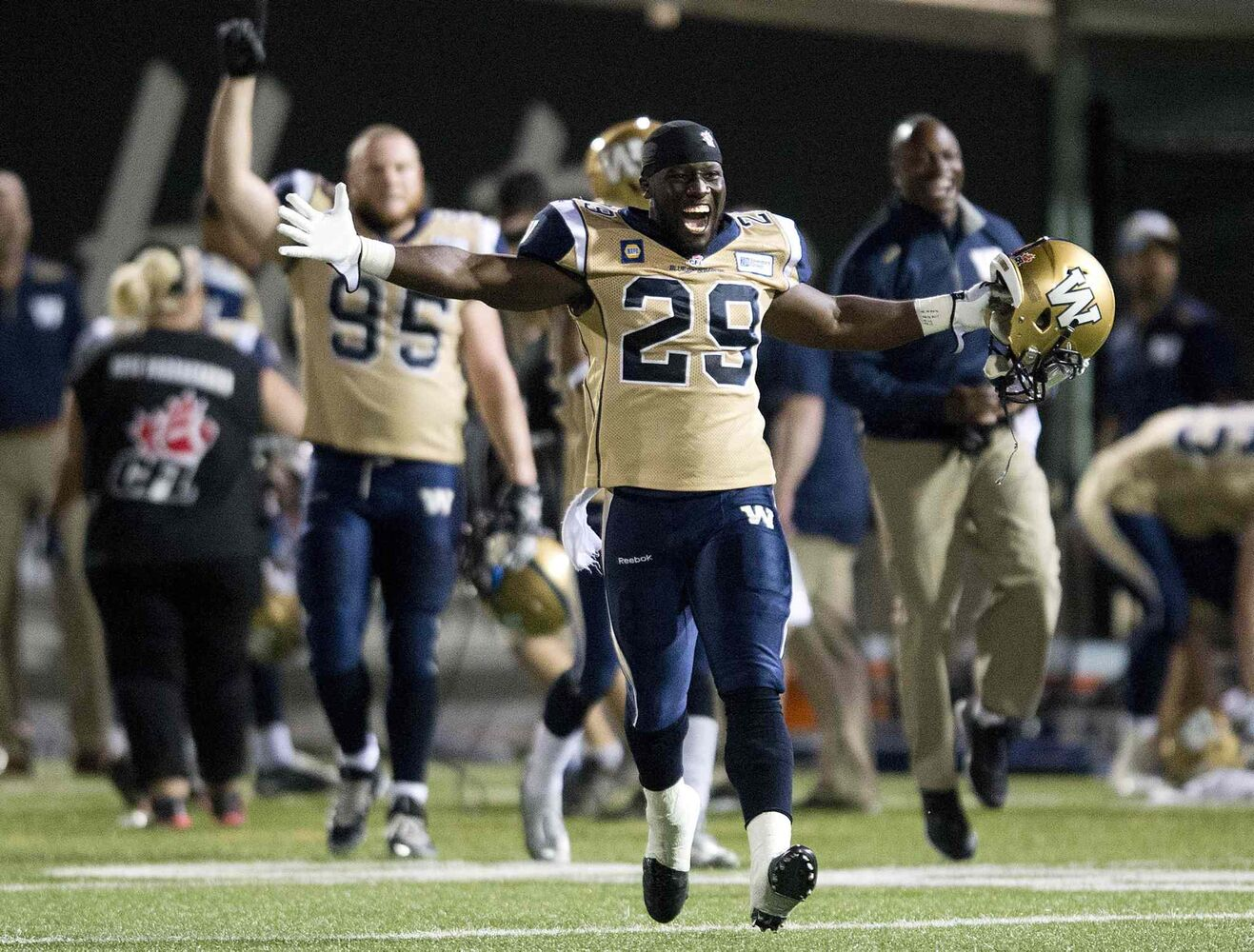 Winnipeg Blue Bombers' running back Carl Volny (29) celebrates after defeating the Hamilton Tiger-Cats 27-26 Thursday night. (Nathan Denette / The Canadian Press)